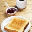 Toast with jam and coffee cup — Stock Photo #58418799