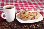 Cookies in plate and coffee cup — Stock Photo