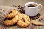 Cookies with nuts and coffee — Stock Photo