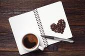 Coffee cup and notepad — Stock Photo