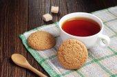 Tea with oatmeal cookie — Stock Photo