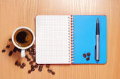 Coffee, opened notebook and pen — Fotografia Stock