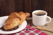 Breakfast with croissant and coffee — Stock Photo