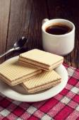 Delicious wafers and coffee — Stock Photo