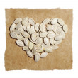 Pumpkin seeds in the shape of hearts — Stock Photo #70194077