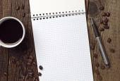 Coffee, opened notebook and pen — Stock Photo