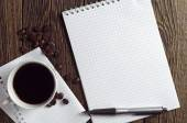 Coffee and opened notebook — Stock Photo