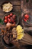 Pasta with ingredients — Stock Photo