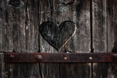 Heart carved in wood — Stock Photo