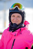 Snowboarder girl in pink in the Alps — Stock Photo