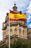 Toledo Cathedral with Spanish flag — Stock Photo