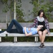Young couple on park bench — Stok fotoğraf #57694025