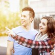 Young couple pointing — Stock Photo #57694041