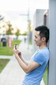 Asian man with cell phone — Stock Photo