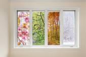 Window view of four seasons — Stock Photo
