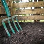 Garden fork turning compost — Stock Photo #63256533
