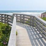 Wooden walkway to ocean beach — Stock Photo #63256747