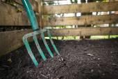 Garden fork turning compost — Stock Photo