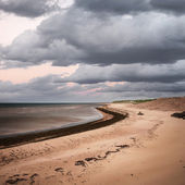 Beach view with storm clouds — Stock Photo