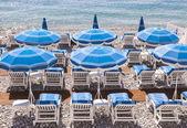 Beach umbrellas in Nice — Stock Photo