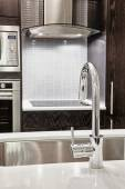 Faucet and sink in modern kitchen — Stock Photo