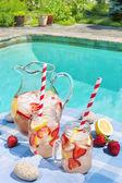 Strawberries lemonade at poolside — Stock Photo