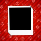 Winter holidays card with blank photo frame on red background — Stock Vector