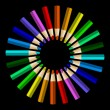 Color pencils in arrange in color wheel colors on black backgrou — Stock Vector #64666305