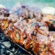 Juicy beef meat on skewers over barbecue — Stock Photo #58697951