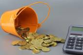 Gold Coins, Calculator and Bucket - Business Concept — Stock Photo