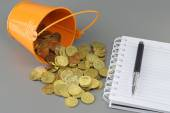 Gold Coins Notepad and Bucket - Business Concept — Stock Photo