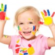 Portrait of a cute little girl playing with paints — ストック写真