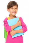 Young girl is holding book — Stock Photo