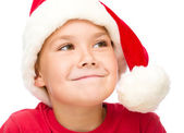 Little girl in santa hat is daydreaming — Stock Photo