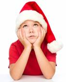 Little girl in santa hat is daydreaming — Foto Stock