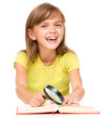Little girl is reading book — Stock Photo