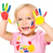 Portrait of a cute little girl playing with paints — Stock Photo #55295521