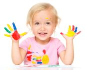 Portrait of a cute little girl playing with paints — Stock Photo