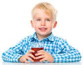 Little boy with glass of cherry juice — Zdjęcie stockowe