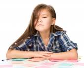 Girl is writing on color stickers — Stockfoto