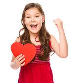 портрет маленькая девочка в красном — Стоковое фото