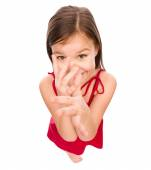 Little girl in red dress showing big nose — Stock Photo