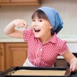 Girl is cooking in kitchen — Stock Photo #74798607