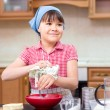 Girl is cooking in kitchen — Stock Photo #74799027
