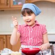 Girl is cooking in kitchen — Stock Photo #74799175