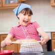 Girl is cooking in kitchen — Stock Photo #74799225
