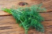 Dill on wooden table — Stock Photo