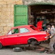 Two mechanics repair old vintage red car  — Stock Photo #67324071