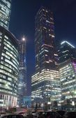 Night view of office buildings — Stock Photo