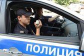 Police in the patrol car. — Stock Photo